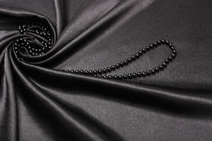 Black silk fabric background Royalty Free Stock Photos