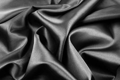 Black silk fabric. Closeup of rippled black silk fabric Stock Images