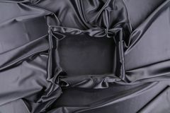 Black silk square. Close up. Whole background. Texture royalty free stock photos