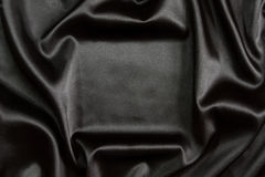 Black silk textile background Royalty Free Stock Photos