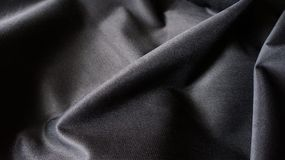 Black Silky Compound Cloth Fabric Curves Texture Backdrop stock photography