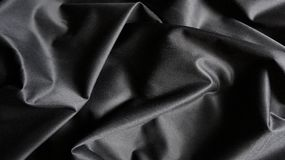 Black Silky Compound Cloth Fabric Curves Texture Background royalty free stock photos