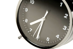 Black and silver alarm clock Stock Images