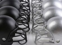 Black and Silver American Football helmets lined up facing each Stock Images