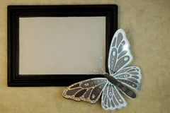 Black and silver butterfly border frame background royalty free stock photo