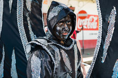 Black and silver carnival. Costumed band member at the Junior Parade of the Bands festivities during Carnival celebrations in Port Of Spain Trinidad Royalty Free Stock Image