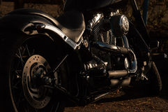 Black and Silver Cruiser Motorcycle on Brown Soil during Night Time Stock Photos