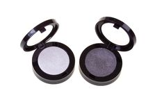 Black and silver eyeshadow. On white background royalty free stock images