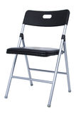 Black And Silver Folding Chair Over White Stock Photo