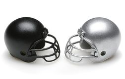 Black and Silver Football Helmets facing each other Royalty Free Stock Image