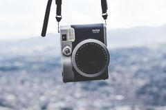 Black and Silver Instax Camera Hanged Near Mountain during Daytime Royalty Free Stock Photos