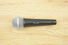 Black and silver microphone. Set switch on place with wood background royalty free stock photos