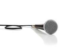 Black and silver microphone on a white background. A black and silver microphone on a white background royalty free stock photo
