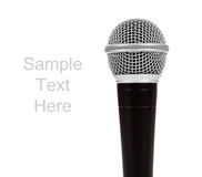 Black and silver microphone on white with text. A black and silver microphone on a white background with copy space Royalty Free Stock Image