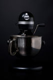 Black and Silver Mixer. A professional black and silver mixer and beater against a black background Stock Photo