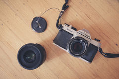 Black and Silver Pentax Digital Camera Beside Black Camera Lens Stock Photography