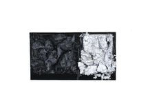 Black and silver scattered in box eye-shadows isolated on white. Black and silver scattered in box eye shadows isolated on white background Royalty Free Stock Image