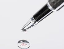 Black, silvery ballpoint pen. Stock Image