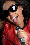 Black Singer. Black karaoke singer with microphone Royalty Free Stock Image