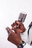 Black Singer hold a microphone Stock Image