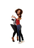 Black sisters loving each other. Two sisters, one small and one big showing there love to each other for white background in the studio royalty free stock photos