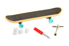 Black skateboard near tools Royalty Free Stock Images