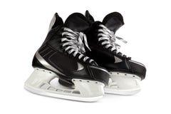 Black skates isolated on white. Pair hockey black skates image isolated on a white background Stock Image