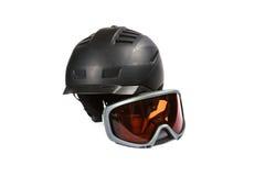 Black ski and snowboard helmet and glasses Stock Photos