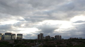 Black Skies Over City. A time-lapse of nearly two hours of a cloudy summer sunset over Mississauga, Ontario, Canada stock video footage
