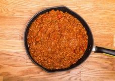 Black Skillet of Hot Chili Stock Photo