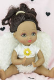 Black skin doll wearing angel suit and wings, girl Royalty Free Stock Photos