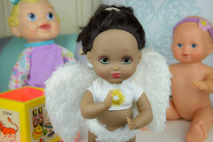 Black skin doll wearing angle suit and wings, girl Royalty Free Stock Images