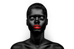 Black-skin female model with a red lips Royalty Free Stock Photo