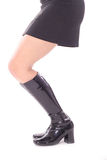 Black skirt & leather boots side Stock Images