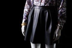 Black skirt, watch and bracelet. Royalty Free Stock Photo