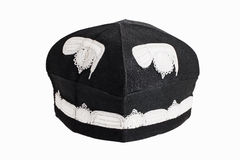 Black skull cap with embroidery. On a white background stock images