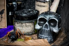 Black skull on the witch`s desk. Close-up royalty free stock photo