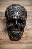 Black skull on wooden table Royalty Free Stock Photos