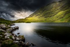 Threatening irish landscape. Black sky of rain over a lake in Kerry, Ireland stock image