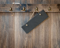 Black Slate. And chalk on wooden panel wall royalty free stock image