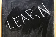 Black slate. With a writing Learn on it Stock Image