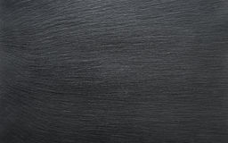 Black slate background. Or textured stony table close-up Stock Image