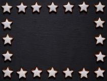 Black slate board with star-shaped cookie frame Stock Images