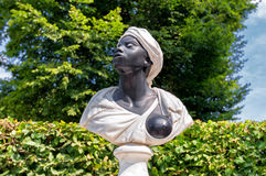 Black slave sculpture. Showing a breast in a public park at Potsdam Stock Image