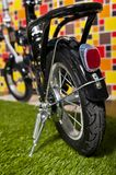 Black small bicycle  on colorful backgroun Stock Photo