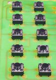 Black small buttons on a green printed circuit board.  royalty free stock image