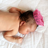 Black small newborn baby in crown Stock Images