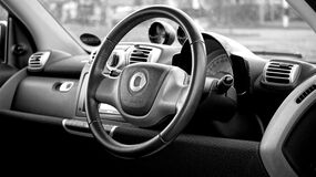 Black Smart Car Steering Wheel Royalty Free Stock Images
