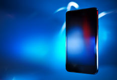 Black smart phone on blue backgroundt, template Stock Photos