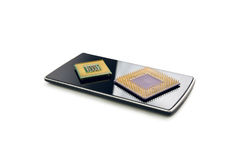Black Smart Phone With Two Computer Processor Chips Royalty Free Stock Photos